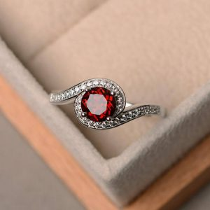 Shop Garnet Rings! Natural red garnet ring, wedding ring, round cut gemstone, January birthstone ring, red gemstone ring, sterling silver ring | Natural genuine Garnet rings, simple unique alternative gemstone engagement rings. #rings #jewelry #bridal #wedding #jewelryaccessories #engagementrings #weddingideas #affiliate #ad