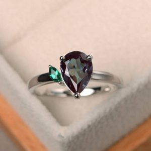 Shop Alexandrite Rings! Alexandrite ring, wedding ring, June birthstone, pear cut gemstone, color changing gemstone, sterling silver ring | Natural genuine Alexandrite rings, simple unique alternative gemstone engagement rings. #rings #jewelry #bridal #wedding #jewelryaccessories #engagementrings #weddingideas #affiliate #ad