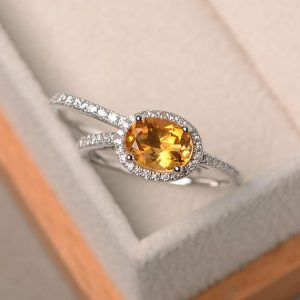 Shop Citrine Rings! Natural citrine ring, November birthstone, oval cut gems, yellow gemstone, sterling silver ring, bridal sets | Natural genuine Citrine rings, simple unique alternative gemstone engagement rings. #rings #jewelry #bridal #wedding #jewelryaccessories #engagementrings #weddingideas #affiliate #ad