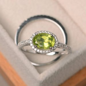 Shop Peridot Rings! Wedding ring, natural peridot ring, August birthstone, oval cut gemstone, green gemstone, bridal sets, sterling silver ring | Natural genuine Peridot rings, simple unique alternative gemstone engagement rings. #rings #jewelry #bridal #wedding #jewelryaccessories #engagementrings #weddingideas #affiliate #ad