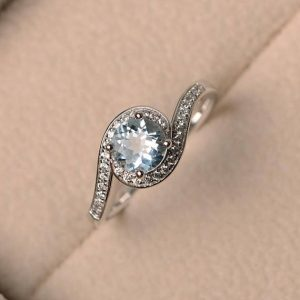 Shop Aquamarine Rings! March birthstone ring, natural aquamarine ring, wedding ring, sterling silver ring, blue gemstone ring,round cut gemstone | Natural genuine Aquamarine rings, simple unique alternative gemstone engagement rings. #rings #jewelry #bridal #wedding #jewelryaccessories #engagementrings #weddingideas #affiliate #ad