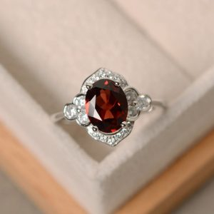 Shop Garnet Rings! Oval garnet ring, engagement ring,sterling silver, January birthstone ring | Natural genuine Garnet rings, simple unique alternative gemstone engagement rings. #rings #jewelry #bridal #wedding #jewelryaccessories #engagementrings #weddingideas #affiliate #ad