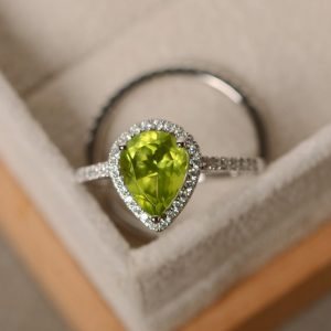 Shop Peridot Rings! Peridot engagement ring, pear cut, sterling silver | Natural genuine Peridot rings, simple unique alternative gemstone engagement rings. #rings #jewelry #bridal #wedding #jewelryaccessories #engagementrings #weddingideas #affiliate #ad