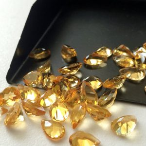 Shop Citrine Faceted Beads! Citrine Cut Stone Lot – Pear Faceted Calibrated Citrine – 5x7mm Each – 15 Pieces, 10 Carats, Beautiful Orange Citrine Lot | Natural genuine faceted Citrine beads for beading and jewelry making.  #jewelry #beads #beadedjewelry #diyjewelry #jewelrymaking #beadstore #beading #affiliate #ad