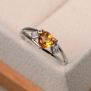 Shop Citrine Rings! Wedding ring, natural citrine ring, trillion cut yellow gemstone, sterling silver ring, November birthstone ring | Natural genuine Citrine rings, simple unique alternative gemstone engagement rings. #rings #jewelry #bridal #wedding #jewelryaccessories #engagementrings #weddingideas #affiliate #ad