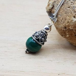 Shop Malachite Necklaces! Minimalist cone Green Malachite pendant necklace. Crystal Reiki jewelry uk.  Filigree Bali silver bead necklace | Natural genuine Malachite necklaces. Buy crystal jewelry, handmade handcrafted artisan jewelry for women.  Unique handmade gift ideas. #jewelry #beadednecklaces #beadedjewelry #gift #shopping #handmadejewelry #fashion #style #product #necklaces #affiliate #ad