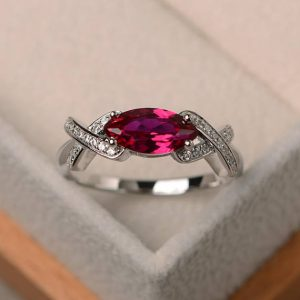 Shop Ruby Rings! Wedding ring, ruby ring, July birthstone ring, marquise cut red gemstone, sterling silver ring | Natural genuine Ruby rings, simple unique alternative gemstone engagement rings. #rings #jewelry #bridal #wedding #jewelryaccessories #engagementrings #weddingideas #affiliate #ad