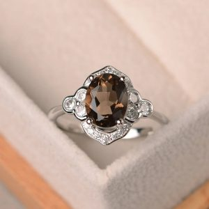 Shop Smoky Quartz Jewelry! Oval smoky quartz ring, oval shaped engagement rings, sterling silver ring, oval ring, gemstone ring | Natural genuine Smoky Quartz jewelry. Buy handcrafted artisan wedding jewelry.  Unique handmade bridal jewelry gift ideas. #jewelry #beadedjewelry #gift #crystaljewelry #shopping #handmadejewelry #wedding #bridal #jewelry #affiliate #ad
