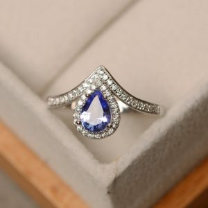 Shop Tanzanite Jewelry! Tanzanite Ring, Pear Cut, Engagement Ring, Tanzanite | Natural genuine Tanzanite jewelry. Buy handcrafted artisan wedding jewelry.  Unique handmade bridal jewelry gift ideas. #jewelry #beadedjewelry #gift #crystaljewelry #shopping #handmadejewelry #wedding #bridal #jewelry #affiliate #ad
