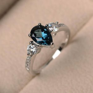 Shop Topaz Rings! November Birthstone Ring, London Blue Topaz Ring, Wedding Ring, Blue Gemstone Ring, Pear Cut Gemstone, Sterling Silver Ring | Natural genuine Topaz rings, simple unique alternative gemstone engagement rings. #rings #jewelry #bridal #wedding #jewelryaccessories #engagementrings #weddingideas #affiliate #ad