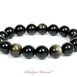 Shop Golden Obsidian Bracelets! 10mm Gold Obsidian Bracelet, Golden Obsidian 10 mm Bracelets, Healing Black Obsidian Bead Bracelet, Gold Sheen Obsidian, Solar plexus Chakra | Natural genuine Golden Obsidian bracelets. Buy crystal jewelry, handmade handcrafted artisan jewelry for women.  Unique handmade gift ideas. #jewelry #beadedbracelets #beadedjewelry #gift #shopping #handmadejewelry #fashion #style #product #bracelets #affiliate #ad