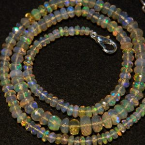 Shop Opal Faceted Beads! Ethiopian Opal Bead, Welo Opal, Faceted Ethiopian Opal Beads, Rondelle Beads, 4mm To 7.5mm Beads, 16 Inch Strand | Natural genuine faceted Opal beads for beading and jewelry making.  #jewelry #beads #beadedjewelry #diyjewelry #jewelrymaking #beadstore #beading #affiliate #ad