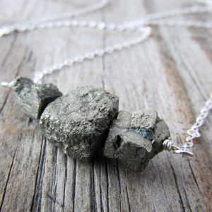 Shop Pyrite Necklaces! Raw Pyrite Necklace, unpolished nuggets of pyrite, bar necklace, swing necklace | Natural genuine Pyrite necklaces. Buy crystal jewelry, handmade handcrafted artisan jewelry for women.  Unique handmade gift ideas. #jewelry #beadednecklaces #beadedjewelry #gift #shopping #handmadejewelry #fashion #style #product #necklaces #affiliate #ad