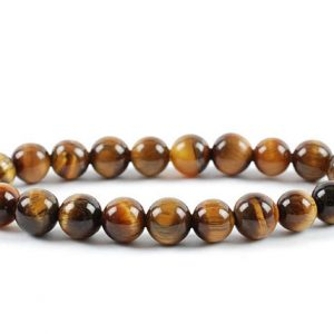 Shop Tiger Eye Bracelets! 8mm Tiger Eye Bracelet, Tiger Eye Bracelets 8 mm, Tiger Eye Bracelet, Healing Tiger Eye Bead Bracelet, Tiger Eye Beads, Stretch Bracelet | Natural genuine Tiger Eye bracelets. Buy crystal jewelry, handmade handcrafted artisan jewelry for women.  Unique handmade gift ideas. #jewelry #beadedbracelets #beadedjewelry #gift #shopping #handmadejewelry #fashion #style #product #bracelets #affiliate #ad