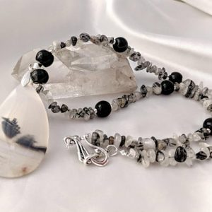 Shop Dendrite Agate Jewelry! Bold Dendritic Agate pendant necklace, with tourmalinated quartz. Gemstone looks like fossils. Black and white natural stones. | Natural genuine Agate jewelry. Buy crystal jewelry, handmade handcrafted artisan jewelry for women.  Unique handmade gift ideas. #jewelry #beadedjewelry #beadedjewelry #gift #shopping #handmadejewelry #fashion #style #product #jewelry #affiliate #ad