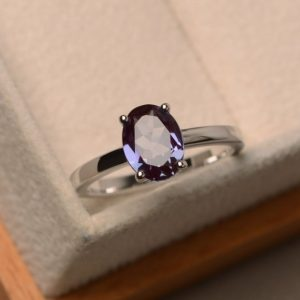 Shop Alexandrite Rings! Color changing alexandrite ring, oval cut silver ring, solitaire ring, anniversary ring | Natural genuine Alexandrite rings, simple unique handcrafted gemstone rings. #rings #jewelry #shopping #gift #handmade #fashion #style #affiliate #ad