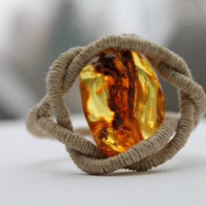 Shop Amber Jewelry! Huge Honey Baltic Amber Bracelet / Eye of dragon / Natural Eco Friendly Jewelry Zen / Pure Organic Linen /  Reserved for  Etsy Design awards | Natural genuine Amber jewelry. Buy crystal jewelry, handmade handcrafted artisan jewelry for women.  Unique handmade gift ideas. #jewelry #beadedjewelry #beadedjewelry #gift #shopping #handmadejewelry #fashion #style #product #jewelry #affiliate #ad