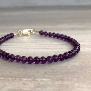 Genuine Amethyst Bracelet | Purple Bead Bracelet | Stackable Silver or Gold Clasp Bracelet | Semi Precious Stone Jewelry | Natural genuine Array jewelry. Buy crystal jewelry, handmade handcrafted artisan jewelry for women.  Unique handmade gift ideas. #jewelry #beadedjewelry #beadedjewelry #gift #shopping #handmadejewelry #fashion #style #product #jewelry #affiliate #ad