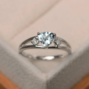 Shop Aquamarine Rings! Natural aquamarine ring, promise ring, March birthstone, trillion cut blue gemstone, sterling silver ring | Natural genuine Aquamarine rings, simple unique handcrafted gemstone rings. #rings #jewelry #shopping #gift #handmade #fashion #style #affiliate #ad