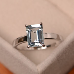 Shop Aquamarine Jewelry! Natural aquamarine ring, solitaire ring, sterling silver, blue gemstone, engagement ring, emerald cut | Natural genuine Aquamarine jewelry. Buy handcrafted artisan wedding jewelry.  Unique handmade bridal jewelry gift ideas. #jewelry #beadedjewelry #gift #crystaljewelry #shopping #handmadejewelry #wedding #bridal #jewelry #affiliate #ad