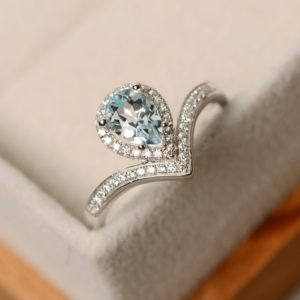 Shop Aquamarine Jewelry! Aquamarine ring, pear cut, sterling silver, engagement ring, March birthstone | Natural genuine Aquamarine jewelry. Buy handcrafted artisan wedding jewelry.  Unique handmade bridal jewelry gift ideas. #jewelry #beadedjewelry #gift #crystaljewelry #shopping #handmadejewelry #wedding #bridal #jewelry #affiliate #ad