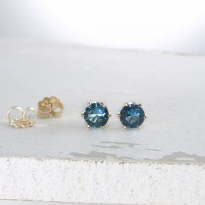 Shop Zircon Jewelry! Blue Zircon December Birthstone Earrings Gold Stud Earrings Blue Stud Earrings Blue Zircon Earrings Birthstone Jewelry Holiday Gift For Her | Natural genuine Zircon jewelry. Buy crystal jewelry, handmade handcrafted artisan jewelry for women.  Unique handmade gift ideas. #jewelry #beadedjewelry #beadedjewelry #gift #shopping #handmadejewelry #fashion #style #product #jewelry #affiliate #ad