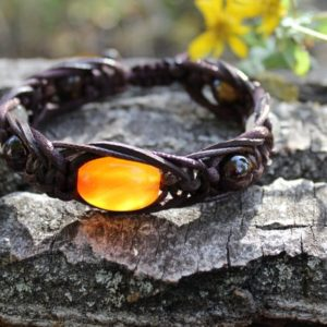 Shop Men's Healing Stone Bracelets! Carnelian Garnet Quartz Tigers Eye Men bracelet Abundance Protection Energy Courage Balance Gem braided Brown leather cord Boho jewelry gift | Natural genuine Hematite bracelets. Buy crystal jewelry, handmade handcrafted artisan jewelry for women.  Unique handmade gift ideas. #jewelry #beadedbracelets #beadedjewelry #gift #shopping #handmadejewelry #fashion #style #product #bracelets #affiliate #ad