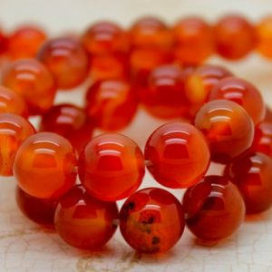 Carnelian Smooth Round Gemstone Beads (4mm 6mm 8mm 10mm) | Natural genuine round Carnelian beads for beading and jewelry making.  #jewelry #beads #beadedjewelry #diyjewelry #jewelrymaking #beadstore #beading #affiliate #ad