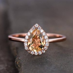 Shop Citrine Rings! Citrine Engagement Ring Plain Rose Gold Band 6x8mm Pear Cut Yellow Gemstone Promise Ring CZ Halo Sterling Silver Bridal Ring Gold Plated | Natural genuine Citrine rings, simple unique alternative gemstone engagement rings. #rings #jewelry #bridal #wedding #jewelryaccessories #engagementrings #weddingideas #affiliate #ad