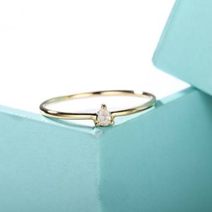 Shop Diamond Jewelry! Minimalist engagement ring Pear Shaped Cut diamond Simple Engagement Ring Promise Women Dainty Stacking Wedding ring Everyday Anniversary | Natural genuine Diamond jewelry. Buy handcrafted artisan wedding jewelry.  Unique handmade bridal jewelry gift ideas. #jewelry #beadedjewelry #gift #crystaljewelry #shopping #handmadejewelry #wedding #bridal #jewelry #affiliate #ad
