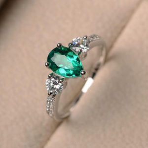 Shop Emerald Engagement Rings! Pear cut gemstone, lab emerald ring, engagement ring, green gemstone ring, sterling silver ring, May birthstone ring | Natural genuine Emerald rings, simple unique alternative gemstone engagement rings. #rings #jewelry #bridal #wedding #jewelryaccessories #engagementrings #weddingideas #affiliate