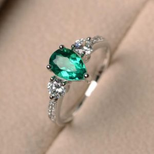 Shop Emerald Engagement Rings! Pear cut gemstone, lab emerald ring, engagement ring, green gemstone ring, sterling silver ring, May birthstone ring | Natural genuine Emerald rings, simple unique alternative gemstone engagement rings. #rings #jewelry #bridal #wedding #jewelryaccessories #engagementrings #weddingideas #affiliate #ad
