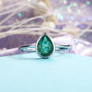 Shop Emerald Engagement Rings! Simple Pear Shaped Emerald Engagement Ring Yellow gold wedding Solitaire bezel set Birthstone  Anniversary | Natural genuine Emerald rings, simple unique alternative gemstone engagement rings. #rings #jewelry #bridal #wedding #jewelryaccessories #engagementrings #weddingideas #affiliate #ad