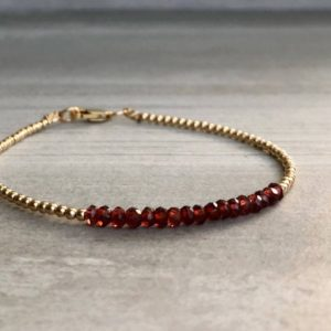 Red Garnet Bracelet | Tiny Silver or Gold Beads | Dainty Genuine Garnet Jewelry | 14K Gold Filled Gift for Wife, Girlfriend | Natural genuine Garnet bracelets. Buy crystal jewelry, handmade handcrafted artisan jewelry for women.  Unique handmade gift ideas. #jewelry #beadedbracelets #beadedjewelry #gift #shopping #handmadejewelry #fashion #style #product #bracelets #affiliate #ad