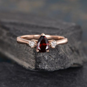 Shop Garnet Rings! Three Stone Garnet Engagement Ring Pear Shaped Rose Gold 3 Stone Bridal Diamond Women Anniversary Gift Drop Tear Wedding Rainbow | Natural genuine Garnet rings, simple unique alternative gemstone engagement rings. #rings #jewelry #bridal #wedding #jewelryaccessories #engagementrings #weddingideas #affiliate #ad