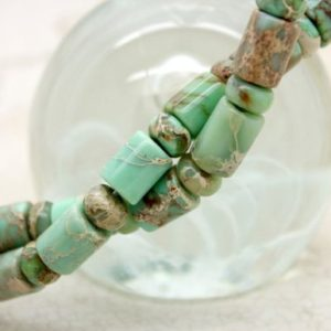 Shop Green Jasper Beads! Green Snake Skin Jasper Rondelle Cylinder Smooth Gemstone Beads | Natural genuine beads Jasper beads for beading and jewelry making.  #jewelry #beads #beadedjewelry #diyjewelry #jewelrymaking #beadstore #beading #affiliate #ad
