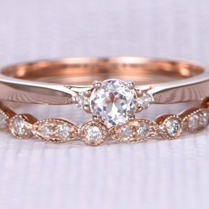 Shop Morganite Engagement Rings! 2pcs Wedding Ring Set Morganite Engagement Ring 14K Rose gold Art Deco Half Eternity Diamond Matching Band 5mm Round Cut Gemstone | Natural genuine Morganite rings, simple unique alternative gemstone engagement rings. #rings #jewelry #bridal #wedding #jewelryaccessories #engagementrings #weddingideas #affiliate #ad