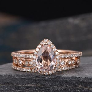 Shop Morganite Jewelry! Pear Shaped Morganite Engagement Ring Bridal Set Rose Gold Stacking Diamond Wedding Bands Unique Bridal 3pcs Art Deco Anniversary Gift Women | Natural genuine Morganite jewelry. Buy handcrafted artisan wedding jewelry.  Unique handmade bridal jewelry gift ideas. #jewelry #beadedjewelry #gift #crystaljewelry #shopping #handmadejewelry #wedding #bridal #jewelry #affiliate #ad