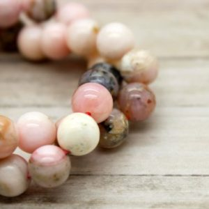 Shop Opal Beads! Pink Opal Round Gemstone Beads (4mm 6mm 8mm) | Natural genuine beads Opal beads for beading and jewelry making.  #jewelry #beads #beadedjewelry #diyjewelry #jewelrymaking #beadstore #beading #affiliate #ad