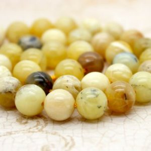 Shop Opal Beads! Yellow Opal Smooth Round Gemstone Beads | Natural genuine beads Opal beads for beading and jewelry making.  #jewelry #beads #beadedjewelry #diyjewelry #jewelrymaking #beadstore #beading #affiliate #ad