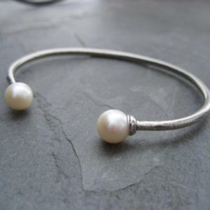 Shop Pearl Jewelry! Double pearl cuff, cultured pearl, silver cuff, gold cuff, twin pearl bracelet, open bangle, genuine pearl, June birthstone, oval bracelet | Natural genuine Pearl jewelry. Buy crystal jewelry, handmade handcrafted artisan jewelry for women.  Unique handmade gift ideas. #jewelry #beadedjewelry #beadedjewelry #gift #shopping #handmadejewelry #fashion #style #product #jewelry #affiliate #ad
