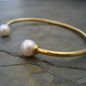 Shop Healing Stone Bracelets! Double pearl cuff, cultured pearl bracelet, June birthstone, natural pearl bangle, bridal open bangle, gold open bracelet, stackable | Natural genuine Gemstone bracelets. Buy handcrafted artisan wedding jewelry.  Unique handmade bridal jewelry gift ideas. #jewelry #beadedbracelets #gift #crystaljewelry #shopping #handmadejewelry #wedding #bridal #bracelets #affiliate #ad
