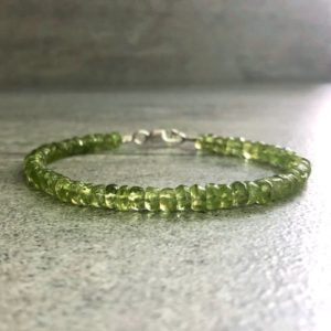 Genuine Peridot Bracelet | Sterling Silver or Gold Clasp | Green Natural Stone Jewelry | Women's or Men's Beaded Bracelet | Natural genuine Peridot bracelets. Buy crystal jewelry, handmade handcrafted artisan jewelry for women.  Unique handmade gift ideas. #jewelry #beadedbracelets #beadedjewelry #gift #shopping #handmadejewelry #fashion #style #product #bracelets #affiliate #ad