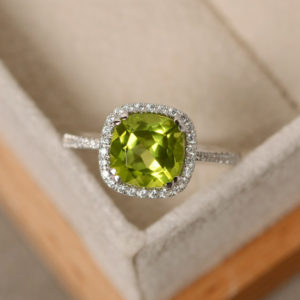 Peridot engagement ring, sterling silver, cushion cut peridot, August birthstone ring, natural peridot gemstone | Natural genuine Peridot rings, simple unique alternative gemstone engagement rings. #rings #jewelry #bridal #wedding #jewelryaccessories #engagementrings #weddingideas #affiliate #ad