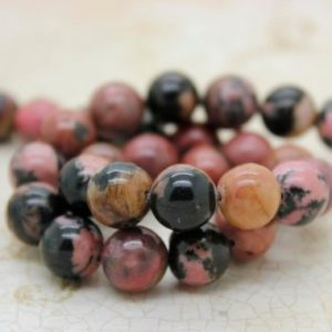 Shop Rhodonite Beads! Rhodonite Smooth Round Natural Gemstone Beads (4mm 6mm 8mm 10mm) | Natural genuine beads Rhodonite beads for beading and jewelry making.  #jewelry #beads #beadedjewelry #diyjewelry #jewelrymaking #beadstore #beading #affiliate #ad