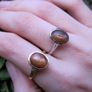 Shop Sunstone Rings! Oval Cabochon Sunstone Ring- Sunstone Stackable Silver Bezel Ring- Orange Gold Gemstone Ring | Natural genuine Sunstone rings, simple unique handcrafted gemstone rings. #rings #jewelry #shopping #gift #handmade #fashion #style #affiliate #ad