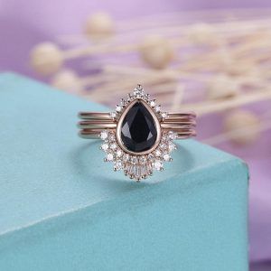 Shop Sapphire Rings! 3PCs Black Sapphire Engagement ring set Rose gold Vintage Diamond/ CZ Wedding band Curved Pear shaped Baguette cut Jewelry Gift for her | Natural genuine Sapphire rings, simple unique alternative gemstone engagement rings. #rings #jewelry #bridal #wedding #jewelryaccessories #engagementrings #weddingideas #affiliate #ad