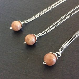Shop Sunstone Pendants! Sunstone necklace – Crystal ball pendant | Natural genuine Sunstone pendants. Buy crystal jewelry, handmade handcrafted artisan jewelry for women.  Unique handmade gift ideas. #jewelry #beadedpendants #beadedjewelry #gift #shopping #handmadejewelry #fashion #style #product #pendants #affiliate #ad