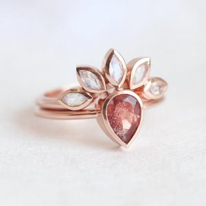 Oregon Sunstone Ring With Matching Rainbow Moonstone Band in 14k Rose Gold, Signature Bridal Set by Minimalvs | Natural genuine Sunstone rings, simple unique alternative gemstone engagement rings. #rings #jewelry #bridal #wedding #jewelryaccessories #engagementrings #weddingideas #affiliate #ad