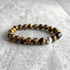 Shop Tiger Eye Bracelets! Mala Bead Bracelet | Gift for Boyfriend | Tiger Eye Bracelet for Men, Women | Healing Crystal Jewelry | Beaded Stretch Bracelet | Natural genuine Tiger Eye bracelets. Buy handcrafted artisan men's jewelry, gifts for men.  Unique handmade mens fashion accessories. #jewelry #beadedbracelets #beadedjewelry #shopping #gift #handmadejewelry #bracelets #affiliate #ad